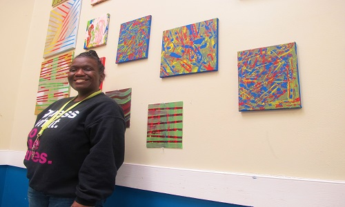 Kiesha Manning pictured with her three piece abstract painting on canvas